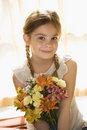 Girl holding flowers. Stock Image
