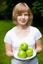 Girl holding fresh green apples Royalty Free Stock Photo