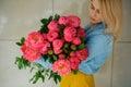 Girl holding fresh pink peony flower Royalty Free Stock Photo