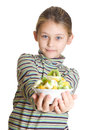 Girl holding fruit dessert little in his outstretched hands Stock Images