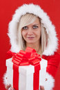 Girl holding a gift Royalty Free Stock Photos