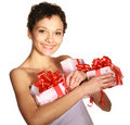 Girl holding a gift boxes Stock Photos