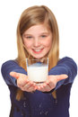 Girl holding glass of milk teenage a on both hands Stock Photos