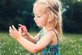Girl holding grasshopper, curiosity and education concept Royalty Free Stock Photo