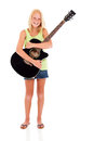 Girl holding guitar cheerful teen a on white background Royalty Free Stock Photography