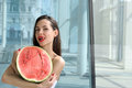 Girl holding half of watermelon and licks his lips her tongue Royalty Free Stock Photo