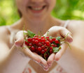 Girl holding a handful of red currants Stock Photography