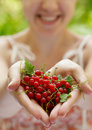 Girl holding a handful of red currants Royalty Free Stock Photography
