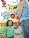Girl holding hands of school teacher in class happy little classroom Stock Photos