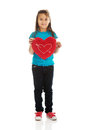 Girl holding heart pillow young Stock Photography