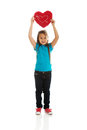 Girl holding heart pillow young Royalty Free Stock Photos