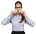 Girl holding a hundred dollar bill in the face of Royalty Free Stock Photography