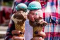 Girl Holding ice cream in the cone Royalty Free Stock Photo