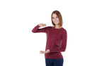 Girl holding an imaginary large board smiling beautiful in red sweater and blue jeans Stock Images