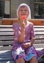 Girl holding jelly candy looks like the heart Royalty Free Stock Photo