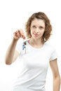 Girl holding keys Royalty Free Stock Image