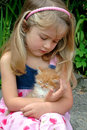 Girl holding kitten Royalty Free Stock Images