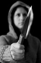 Girl holding a knife on dark background Royalty Free Stock Photo