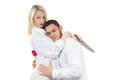Girl holding knife traitor man with rose in his a men a hand on a white background Royalty Free Stock Photo
