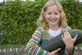 Girl holding large squash Royalty Free Stock Photo