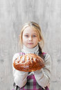 girl holding a loaf of bread Royalty Free Stock Photo