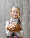 Girl holding a loaf of bread little outstretched hands Royalty Free Stock Photo