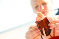 Girl eats lobster claw Royalty Free Stock Photo