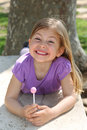 Girl holding lollipop Royalty Free Stock Photo