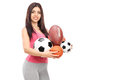Girl holding lots of different kind of sports balls isolated on white background Stock Photo
