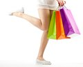 Girl holding multicolored shopping paper bags Royalty Free Stock Photo
