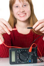 Girl holding multimeter plugs Royalty Free Stock Image