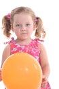 Girl holding orange balloon little Stock Images