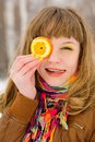 Girl Holding Orange Slice