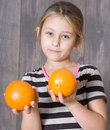 Girl holding oranges little two Stock Photography