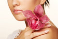 Girl holding orchid flower beautiful in her hands Stock Photos