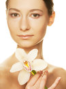 Girl holding orchid flower beautiful in her hands Royalty Free Stock Image