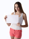 Girl holding paper blank Royalty Free Stock Photography
