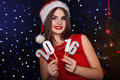 Girl is holding paper digits christmas time pretty smiling wearing red fashion dress silver smiling beautiful woman portrait on Royalty Free Stock Photo