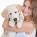 Girl holding pet labrador puppy Royalty Free Stock Photo