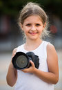 Girl holding photo camera