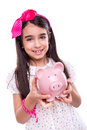Girl holding a piggy bank young over white background Royalty Free Stock Photos