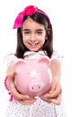Girl holding a piggy bank young over white background Stock Photography