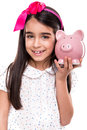 Girl holding a piggy bank young over white background Stock Images