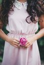 Girl Holding A Pink Rose In He...