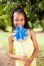 Girl holding pinwheel Stock Photo