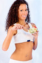 Girl holding plate with salad pretty fitness and fork Stock Photo