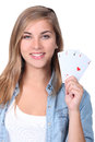 Girl holding playing cards young Royalty Free Stock Image