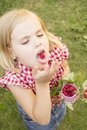 Girl holding raspberries in her hand beautiful hands and eats Stock Photography