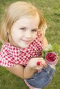 Girl holding raspberries in her hand beautiful hands and smiling Stock Photo