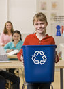Girl holding recycling bin Stock Photo